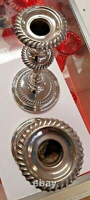 A Pair of Vintage Silver Candlesticks